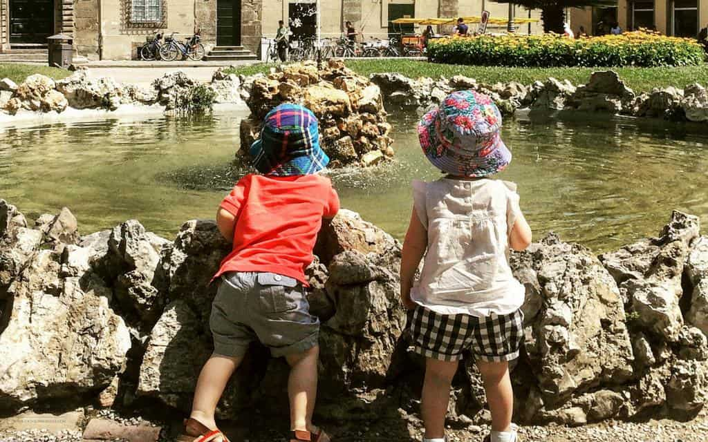 children looking fountain in lucca