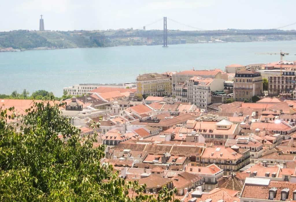 Lisbon - View of the Tagus River, Ponte 25 de Abril and Cristo Rei statue from Castelo de São Jorge, Lisbon
