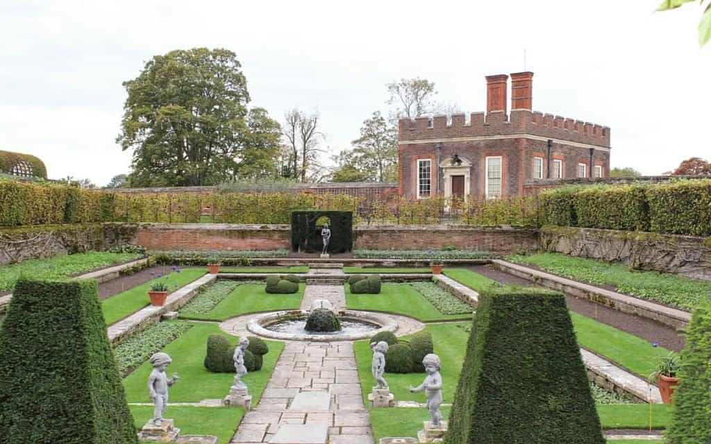 formal gardens and banqueting house at hampton court