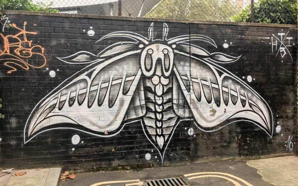 GCAK moth mural seen on Street Art London walking tour