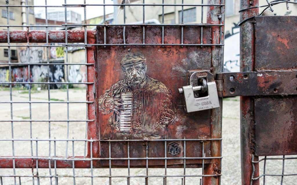 Artist C215 stencil portrait of accordion man in East London