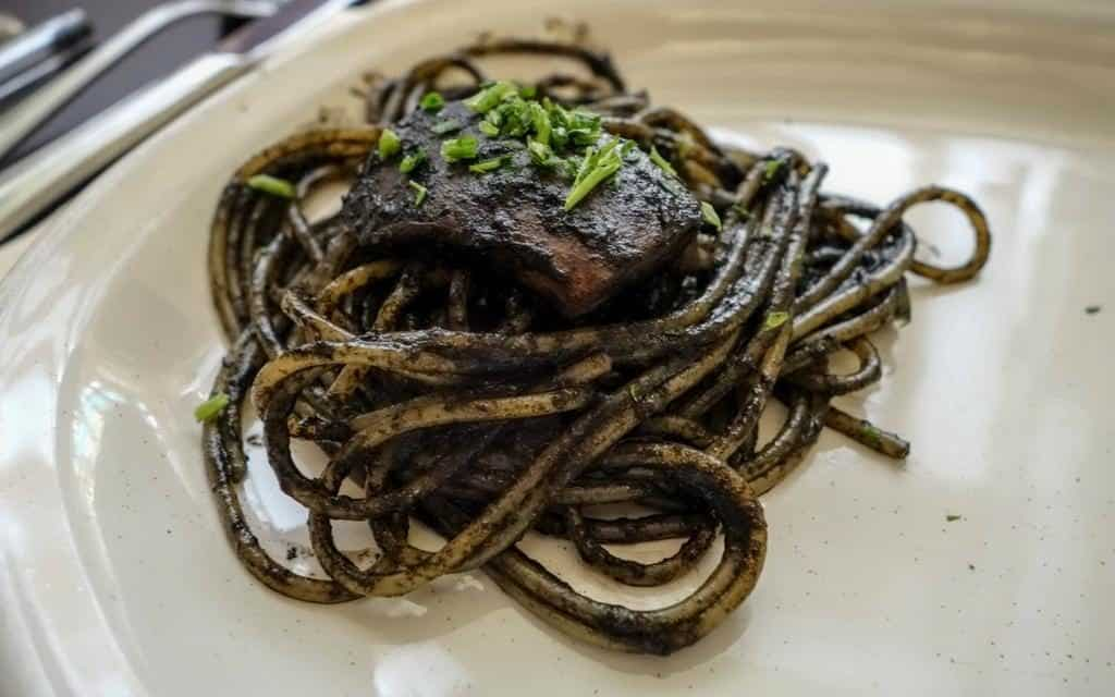 Black squid ink pasta is typical of Venetian cuisine