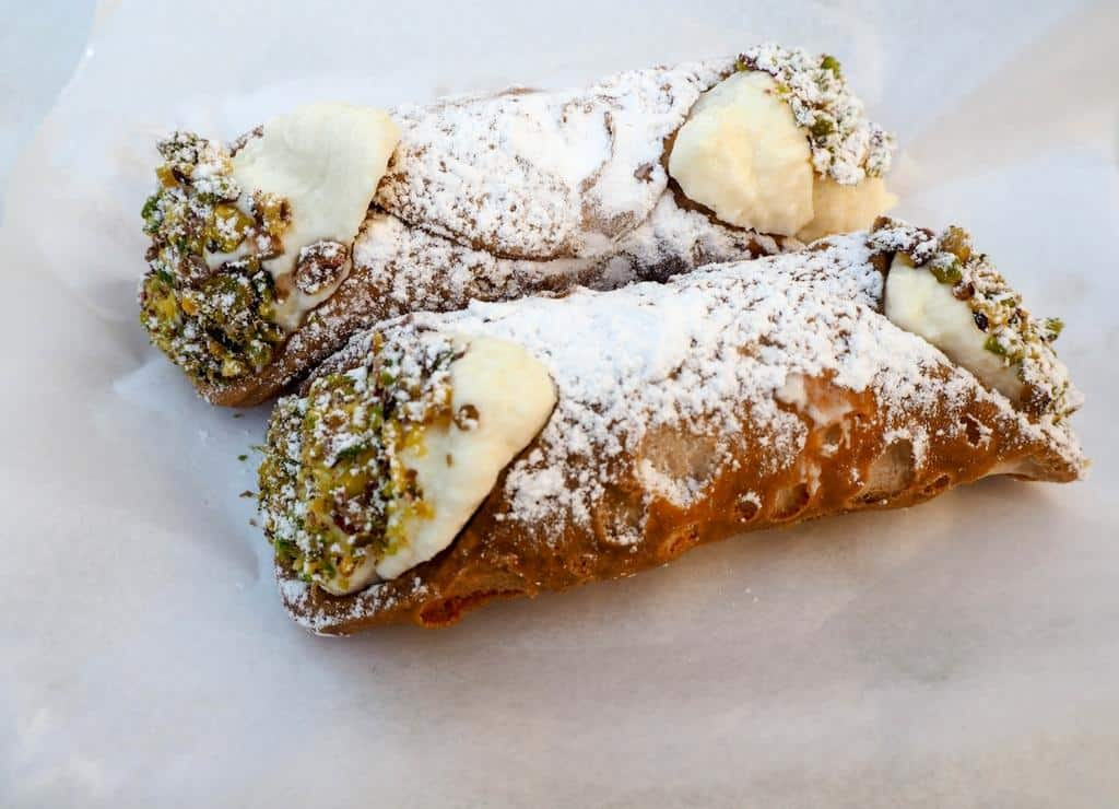 Eat cannoli in Sicily