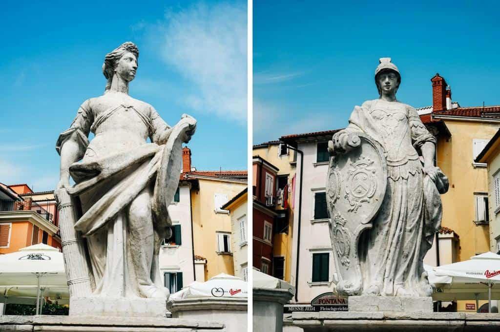 statues in Maj trg Piran